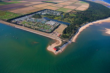 Aerial view of lifeboat station, beach huts and caravan park at Wells-Next-The-Sea, Norfolk, England, UK, September 2009.