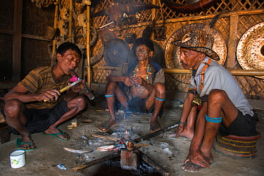 Konyak Naga opium smokers. Mon district. Nagaland,  North East India, October 2014.