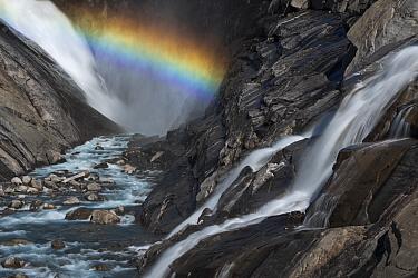 View of a rainbow in the spray of Bjornefossen Waterfall, Saltfjellet-Svartisen National Park, Norway, August 2015.