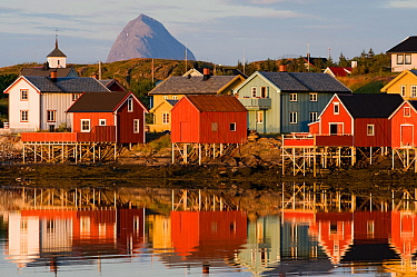 The fishing village of Lovund, with the top of Tomskjevelen (Tomma island) in the background, Luroy, Helgeland, Nordland, Norway, July 2009.