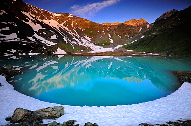 View of Lac Blanc from the refuge at Peclet Polset, Vanoise National Park, Savoie, France, July.