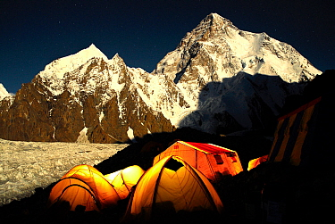 Broad Peak base camp (4,960 m) at night, with K2 (8,611m) and the Godwin-Austen glacier in the background lit by moonlight, Central Karakoram National Park, Pakistan, June 2007. Winner of Photographer...
