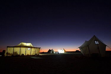 View of a BBC filming camp at night, on location for the Sahara episode of the 'Africa' series, Egypt, September 2011.
