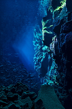 A view down Nikulasargj Canyon, deep fault filled with fresh water in the rift valley between the Eurasian and American tectonic plates at Thingvellir National Park, Iceland. May 2011. In this photo t...