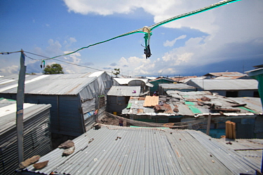 Basic electric wiring linking homes in a slum with a diesel powered generator, Remba Island, Lake Victoria, Kenya.