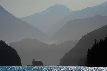 Mountains silhouetted in fog, Knight Inlet, East Coast, Vancouver Island, British Columbia, Canada, July.