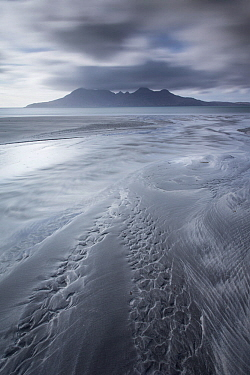 Isle of Rum at sunset viewed from Eigg, Scotland, April 2013.
