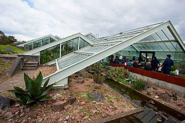 Visitors in the entrance of the Princess of Wales Conservatory, Kew Gardens, London, UK. 23 April 2016
