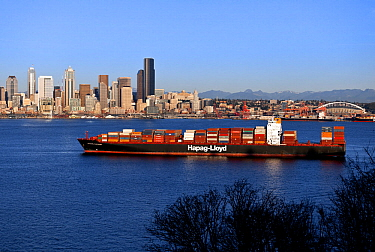 Freighter ship anchored, Elliot Bay, with the city of Seattle in the background. Washington, USA, February 2015.