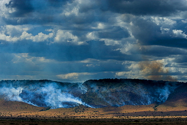 Bushfires in dry season on the Isuria escarpment, Masai-Mara Game Reserve, Kenya. October 2007.