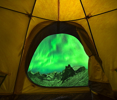 Aurora borealis / Northern Lights seen from entrance to tent, Brooks Range, Gates of the Arctic National Park, Alaska, USA, September 2014.