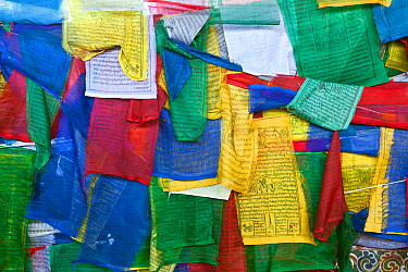 Prayer flags covering the side of Kuendeying Bazzam Bridge over the Wang Chhu in Thimphu. Bhutan, October 2014.