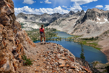 Day hiker on trail above Twin Lakes, Sawtooth Wilderness, Sawtooth National Recreation Area, Idaho, USA. July 2015. Model released.