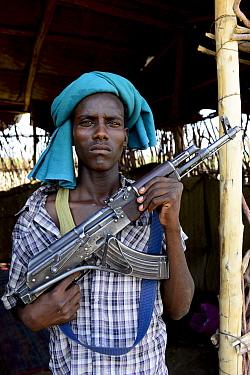 Afar man with rifle, Danakil Depression, Afar Region, Ethiopia, Africa. November 2014.