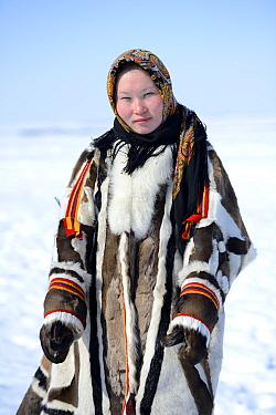 Carolina Serotetto, Nenet teenager in traditional winter coat made with reindeer skin. The collar is arctic fox fur and black beaver with felt ribbons. Yar-Sale district, Yamal, Northwest Siberia, Rus...