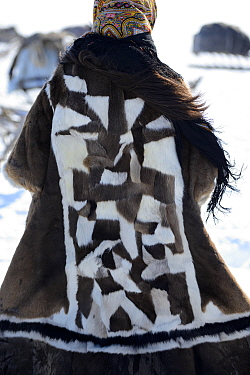 Nenet teenager dressed in traditional winter coat made with reindeer skin.  Yar-Sale district, Yamal, Northwest Siberia, Russia. April 2016.