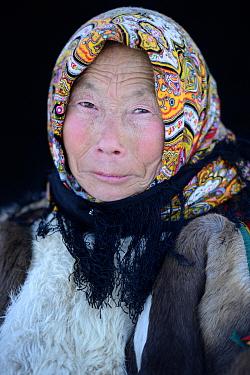 Tatiana Salinder, portrait of Nenet herder in winter coat made of reindeer fur. The collar is arctic fox fur. Yar-Sale district, Yamal, Northwest Siberia, Russia, April 2016