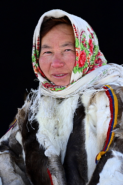 Natacha Serotetto, portrait of Nenet herder in winter coat made from reindeer fur. The collar is made of arctic fox fur, black beaver fur strap decoration and felt ribbons. Yar-Sale district, Yamal, N...
