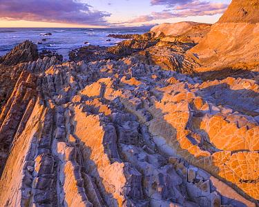 Sunset over coast of Montana de Oro State Park in California, USA December.