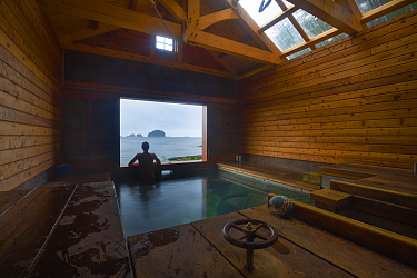 Person in White sulphur hotsprings, Chichagof island, South East Alaska, USA, July. model released