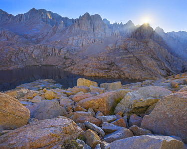 The first rays of sunshine above the Sierra Crest, illuminating granite, Mitre Basin, Sierra Nevada, Sequoia National Park, California, USA, August