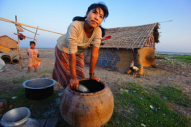 Rakhine girl washing up after a day of subsistence shellfish collecting on an ephemeral barrier island in the Bengal Sea, Rakhine State, Myanmar, 2012