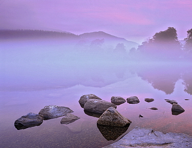 Mist over Coniston Water before dawn. Lake District, Cumbria, England.