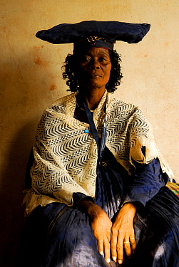 Herero woman in traditional dress - influenced by Victorian missionaries, Kaokoland, Namibia. February 2005