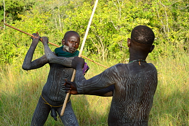 'Donga' stick fighters, young men of the Suri / Surma tribe. Omo river Valley, Ethiopia, September 2014.