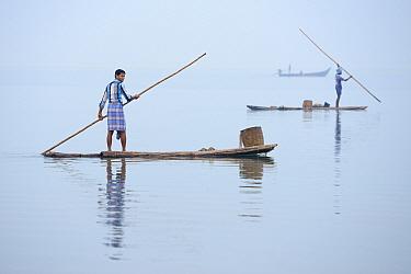 Throw-net fishermen on raft, Pulicat Lake, Tamil Nadu, India, January 2013.