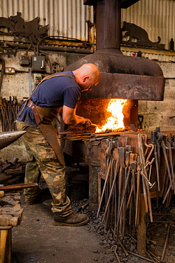 A rural blacksmith at work, Cherington Forge, Cherington, Gloucestershire, UK. September 2015.
