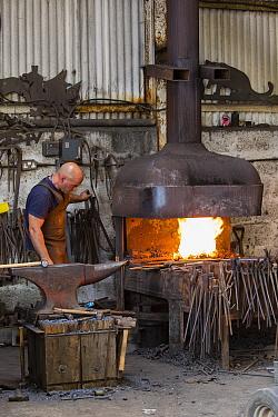 Rural blacksmith at work, Cherington Forge, Cherington, Gloucestershire, UK. September 2015.