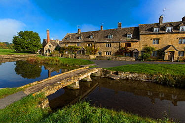 Cotswolds village of Lower Slaughter with stone clapper bridge, Gloucestershire, UK. October 2015.