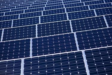 Photovoltaic panel array on a solar farm, UK.