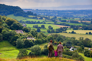 Family walking on Selsley Common on the Cotswold Way, Gloucestershire, UK.August 2012. Model Released.