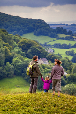 Family walking on Selsley Common on the Cotswold Way, Gloucestershire, UK. August 2012. Model Released.