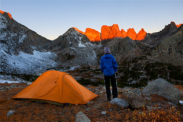 Sunrise over campsite in Cirque Of Towers area, Popo Agie Wilderness, Wind River Range, Shoshone National Forest, Wyoming, USA. September 2015. Model released.