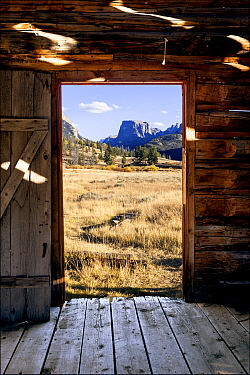 View through doorway of Osborn Cabin of Squaretop Mountain in Green River Valley, Bridger National Forest, Wyoming, USA. September 2015.