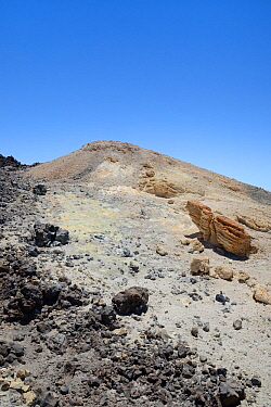 Fumarole field near the summit of Mount Teide volcano, with lava rock and pumic deposits stained yellow by sulphurous gas emissions, Tenerife, May.
