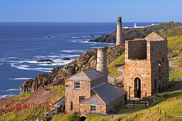 Levant tin mine and distant Pendeen Lighthouse, Trewellard, Cornwall, England, UK. June 2015.
