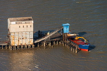 Aerial view of loading sugar on barge to export, coastal Guyana, South America