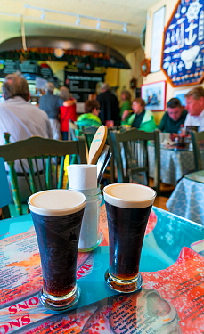 Two halves of Guinness in restaurant, Dingle Village, Dingle Peninsula, County Kerry, Ireland, Europe. September 2015.