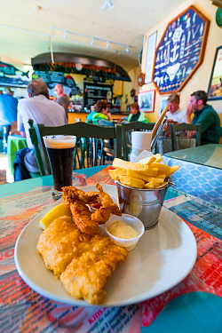 Plate of fish and chips in  restaurant, Dingle Village, Dingle Peninsula, County Kerry, Ireland, Europe. September 2015.