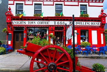 Painted hotel facade and cart in Knightstown, Valentia Island, Iveragh Peninsula, County Kerry, Ireland, Europe. September 2015.