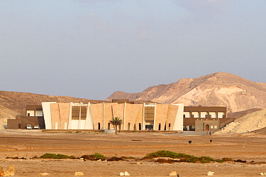 Hotel and museum designed to blend in with  surrounding mountains at Ras Al Jinz Turtle Reserve, a popular tourist destination, Oman, November 2012.