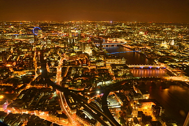 Aerial view of River Thames and London, lit at night, England, UK. October 2014.