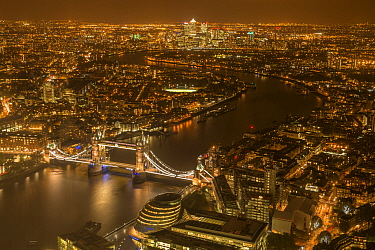 Aerial view of River Thames and Tower Bridge in London at night. October 2014.