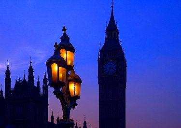 Street lighting, Houses of Parliament and Big Ben silhouetted, Westminster, London, England, UK, November.