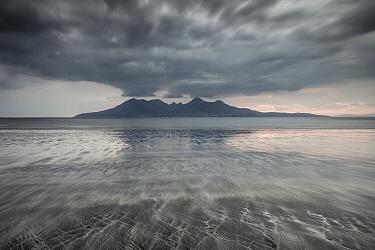 Bay of Laig, Isle of Eigg towards Isle of Rum, Inner Hebrides, Scotland, UK, April 2014.