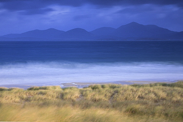 View across Sound of Taransay to North Harris hills in stormy weather , West Harris, Outer Hebrides, Scotland, UK, September 2014.